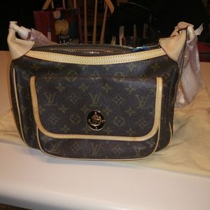 Vintage authentic Louis Vuitton.